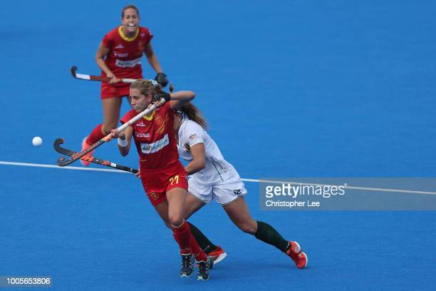 Cristina Guinea of Spain controls he ball in the air as Dirkie Chamberlain of South Africa looks to tackle her during the Pool C game between Spain...
