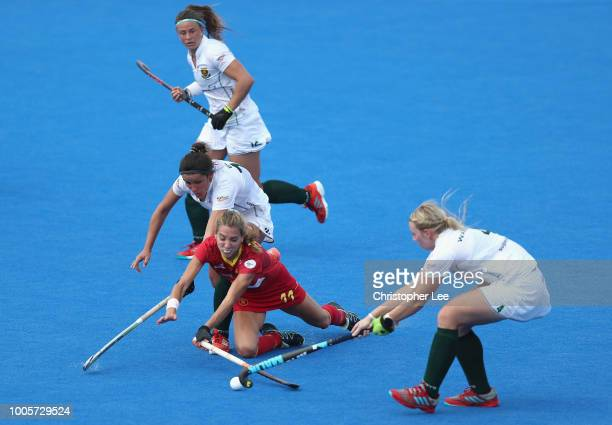 Cristina Guinea of Spain goes down as she battles with KaraLee Botes of South Africa and Nicole Walraven of South Africa during the Pool C game...