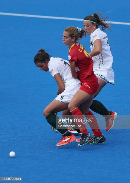 Cristina Guinea of Spain is squashed by KaraLee Botes of South Africa and Dirkie Chamberlain of South Africa during the Pool C game between Spain and...