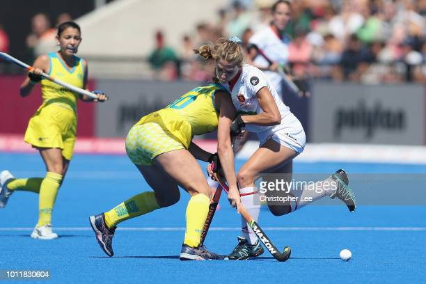 Cristina Guinea of Spain runs into Grace Stewart of Australia during the Third Place Play Off game between Australia and Spain of the FIH Womens...