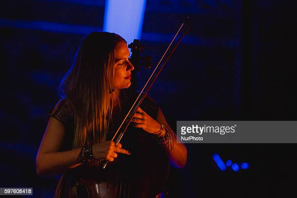 Cristina Lopez cello performs with Ara Malikian during the cultural summer nights at Cathedral square in Zamora northwest Spain on August 28 2016
