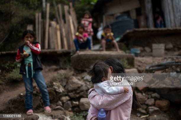 Cristina Moreno carries her baby at her home in Juquila Yuvinani village, Metlatonoc municipality, Guerrero state, Mexico, on May 16, 2021. - In this...