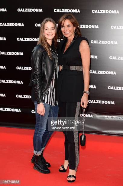 Cristina Parodi and her daughter Benedetta arrive at the Calzedonia 'Forever Together' show on April 16, 2013 in Rimini, Italy.