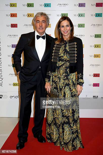 Cristina Parodi and Massimo Giletti attend a photocall for the MAXXI Acquisition Gala Dinner 2016 at Maxxi Museum on November 7 2016 in Rome Italy