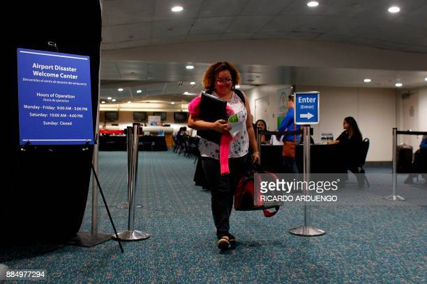 Cristina Sanchez leaves the Reception Center for Puerto Rican refugees set up at the Orlando International Airport after getting after obtaining...