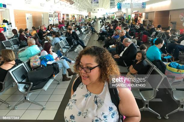 Cristina Sanchez waits to board a flight to Orlando, Florida at a Luis Munoz Marin International Airport terminal in San Juan, Puerto Rico on...