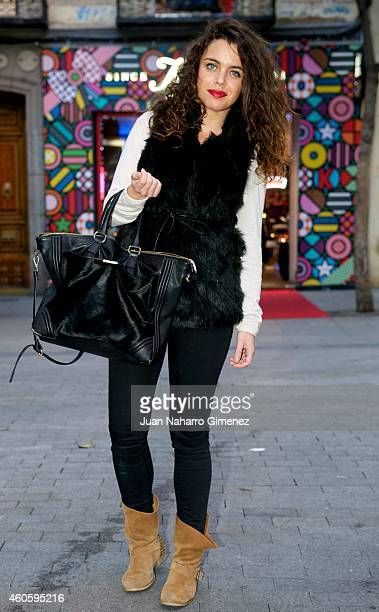 Cristina wearing Stradivarius boots trousers and waistcoat and Zara handbag and sweater on December 17 2014 in Madrid Spain