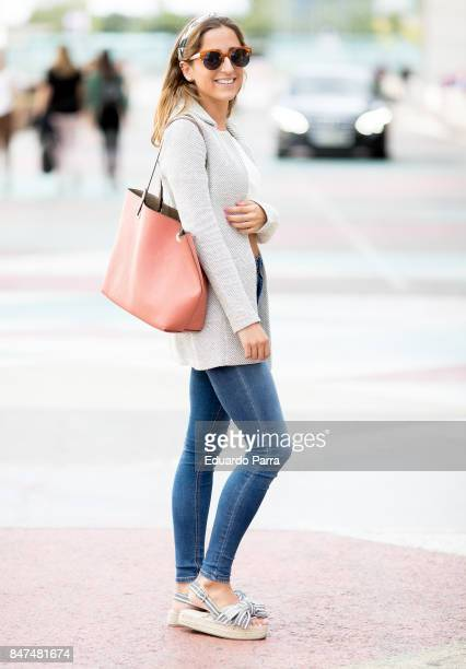 Cristina wears a CA jacket Pull Bear trousers Parfouis handbag and Stradivarius shoes during the Mercedes Benz Fashion Week Spring/Summer 2018 at...