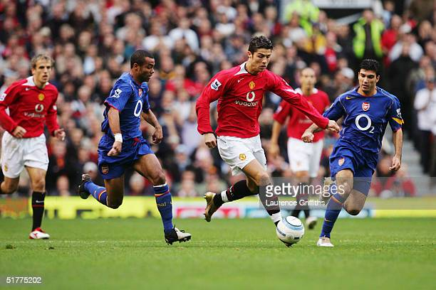 Cristino Ronaldo takes on Ashley Cole and Jose Antonio Reyes during the FA Barclays Premiership match between Manchester United and Arsenal at Old...