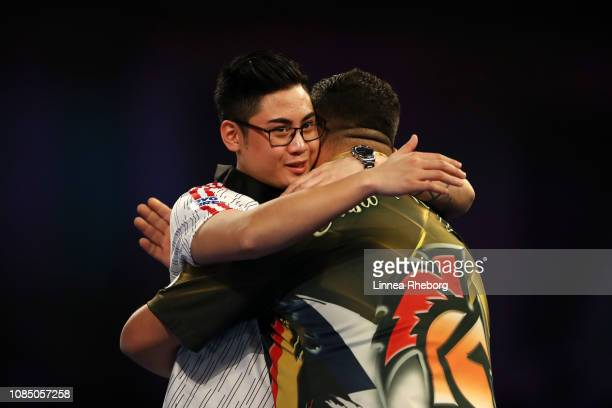Cristo Reyes of Spain and RowbyJohn Rodriguez of Austria hug each other after their second round match during Day Eight of the 2019 William Hill...