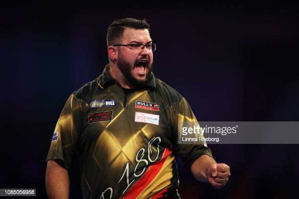 Cristo Reyes of Spain celebrates in his second round match against RowbyJohn Rodriguez of Austria during Day Eight of the 2019 William Hill World...