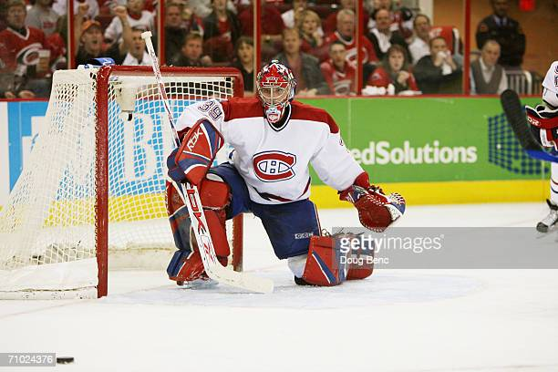 Cristobal Huet of the Montreal Canadiens tends goal against the Carolina Hurricanes in game one of the Eastern Conference Quarterfinals during the...