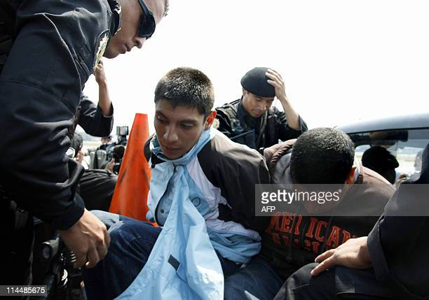 Cristofer Jose Cardona Chen and Danny Pacheco alleged members of Mexican drug cartel Los Zetas are escorted by members of the National Civil Police...