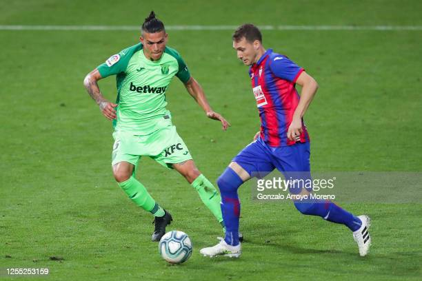 Cristoforo of SD Eibar competes for the ball with Jonathan Silva of CD Leganes during the Liga match between SD Eibar SAD and CD Leganes at Ipurua...