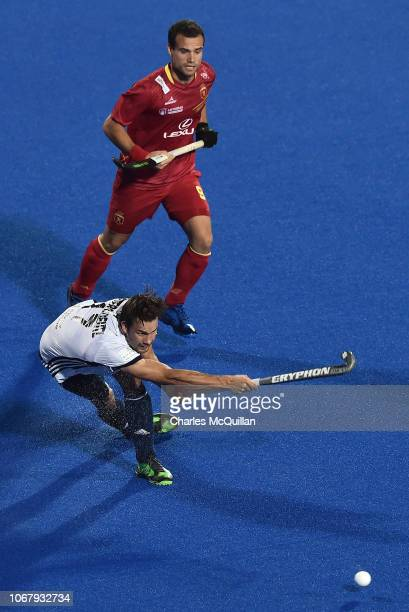 Cristoforo PetersDeutz of France shoots as Alvaro Iglesias of Spain looks on during the FIH Men's Hockey World Cup Pool A match between Spain and...