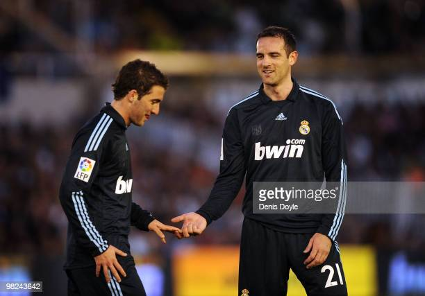 Cristoph Metzelder of Real Madrid congratulates Gonzalo Higuain after Higuain was substituted during the La Liga match between Racing Santander and...