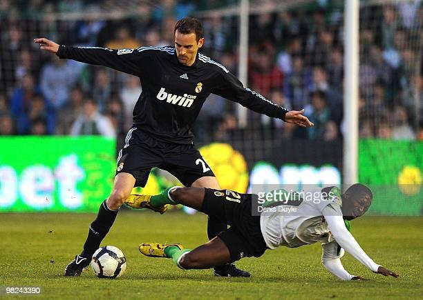 Cristoph Metzelder of Real Madrid tackles Papakouly Diop of Racing Santander during the La Liga match between Racing Santander and Real Madrid at El...