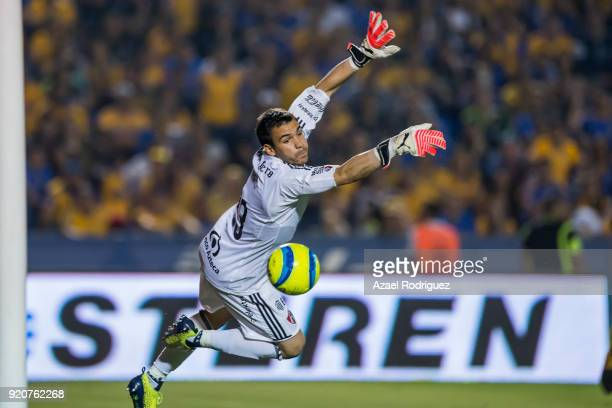 Cristopher Toselli goalkeeper of Atlas attempts a save of the opening goal scored by AndrePierre Gignac of Tigres during the 8th round match between...