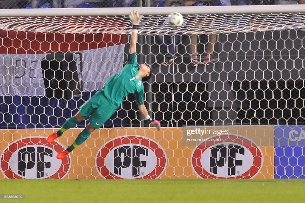 Cristopher Toselli goalkeeper of Chile receives a goal scored by Oscar Romero of Paraguay during a match between Paraguay and Chile as part of FIFA 2018 World Cup Qualifiers at Defensores del Chaco Stadium on September 01, 2016 in Asuncion, Paraguay.