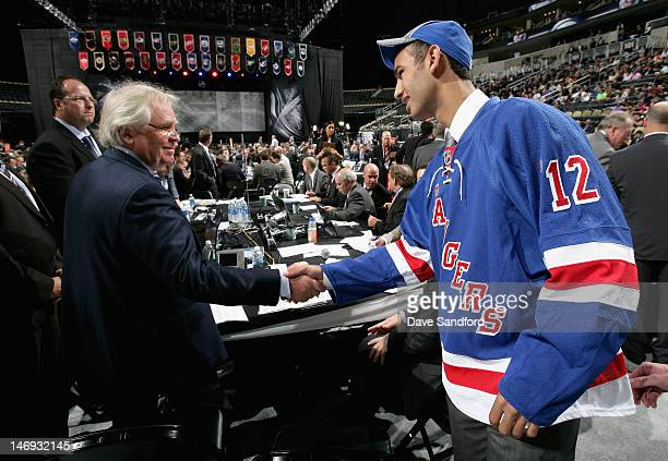 Cristoval Nieves drafted 59th overall by the New York Rangers greets President and general manager Glen Sather during day two of the 2012 NHL Entry...
