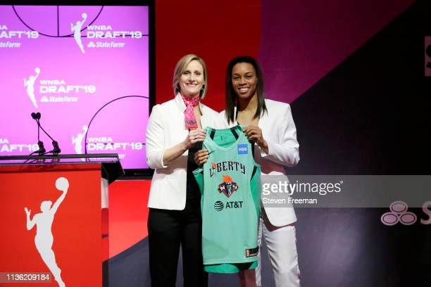 Cristy Hedgpeth poses with Asia Durr after being drafted as the number two overall pick by the New York Liberty during the 2019 WNBA Draft on April...