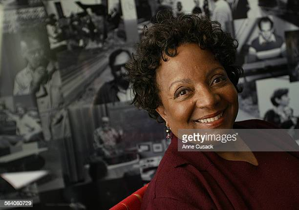 Cristyne Lawson photographed in front of photos of Cal ARts in the lobby of the Redcat Theater The Dean and Artistic Director of the School of Dance...