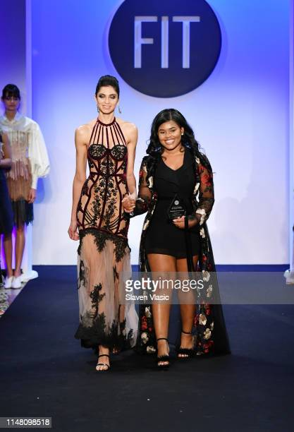 Critic Award winner Intimate Apparel Dorshelle Guillaume walks the runway with winning design during the FIT Future Of Fashion Runway Show on May 09...