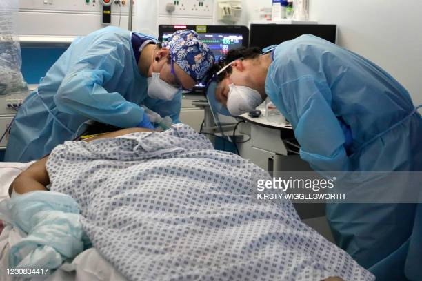 Critical Care staff look after a Covid-19 patient on the Christine Brown ward at King's College Hospital in London on January 27, 2021. - The scale...