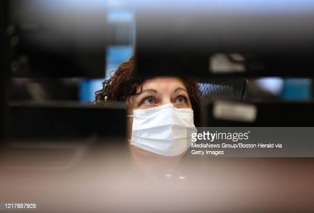 Critical care staff nurse Valerie Vittoriso monitors intensive care unit patients from the Steward eICU Program on April 7 2020 in Westwood...