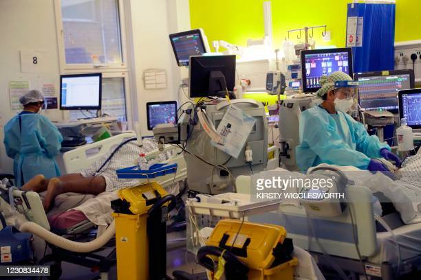 Critical Care staff take care of Covid-19 patients on the Christine Brown ward at King's College Hospital in London on January 27, 2021. - The scale...