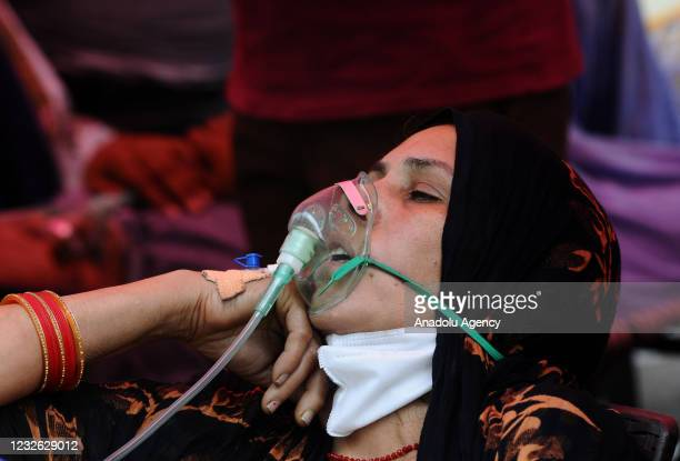 Critical patients receive free oxygen provided by a Gurdwara, amid rise in coronavirus cases across the country in Ghaziabad at Uttar Pradesh on...