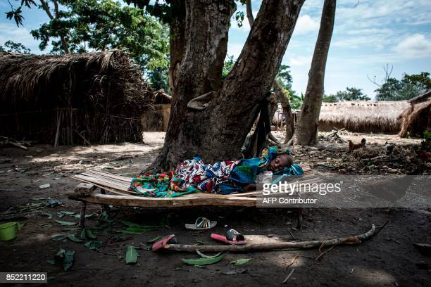 TOPSHOT A critically sick young refugee from Central African Republic lies in a refugee site on the outskirts of the town of MobayiMbongo in the...