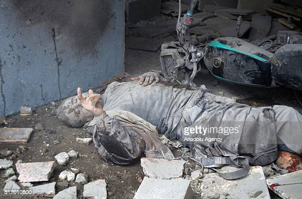 A critically wounded man lays on the ground after Russian airstrikes hit residential areas in Ariha District of Idlib Syria on February 24 2016 At...