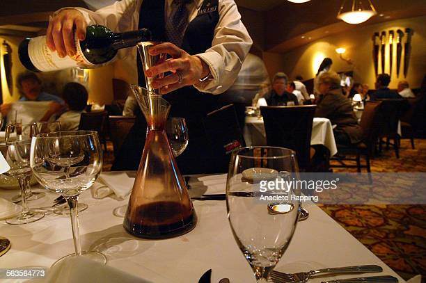 Critic's Notebook looks at Ruth's Chris restaurant in Woodland Hills with it's California Bungalow design Darlene Mann server pours a bottle of red...