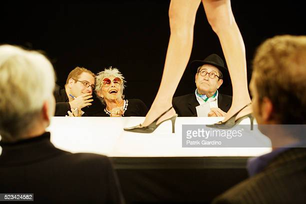 critics reacting during fashion show - fashion show stock pictures, royalty-free photos & images