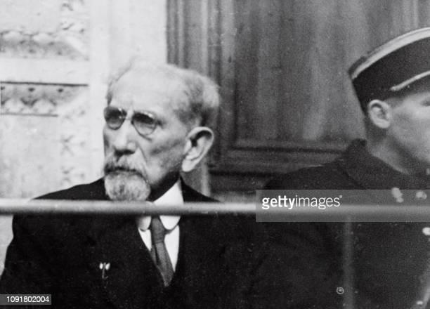L'écrivain et homme politique Charles Maurras assis sur le banc des accusés assiste à son procès le 25 janvier 1945 au Palais de justice de Lyon Il...
