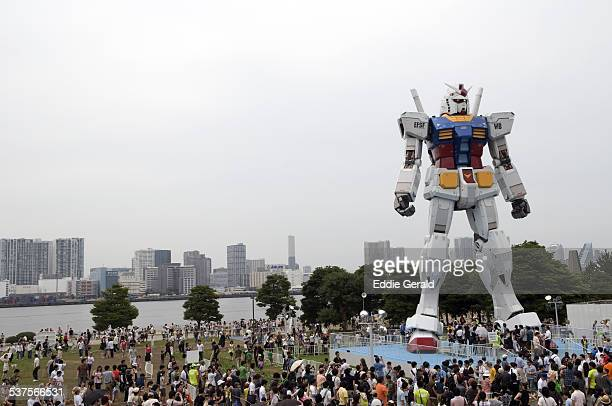 Criwd surround a giant massive replica of robot animation Gundam in Odaiba seaside Tokyo Japan