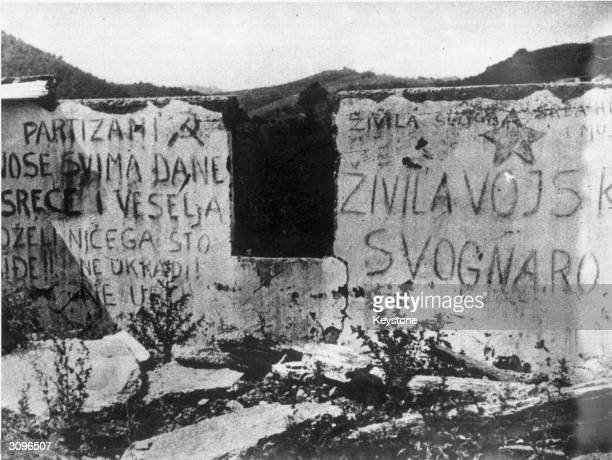 Croat slogans scrawled on a wall urge Yugoslavs to organise resistance against the Germans On the left 'The partisans will bring them days of joy and...