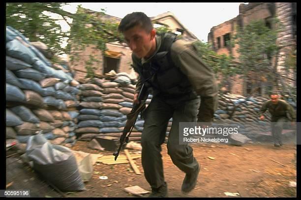 Croat soldier of HVO force running on civil war front on western bank of Neretua River Mostar BosniaHerzegovina