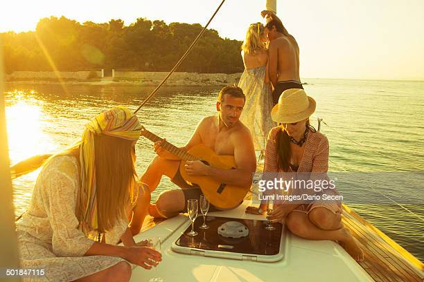 Croatia, Adriatic Sea, Young people on boat celebrating together