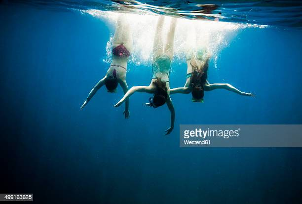 Croatia, Brac, Sumartin, Three girls under water