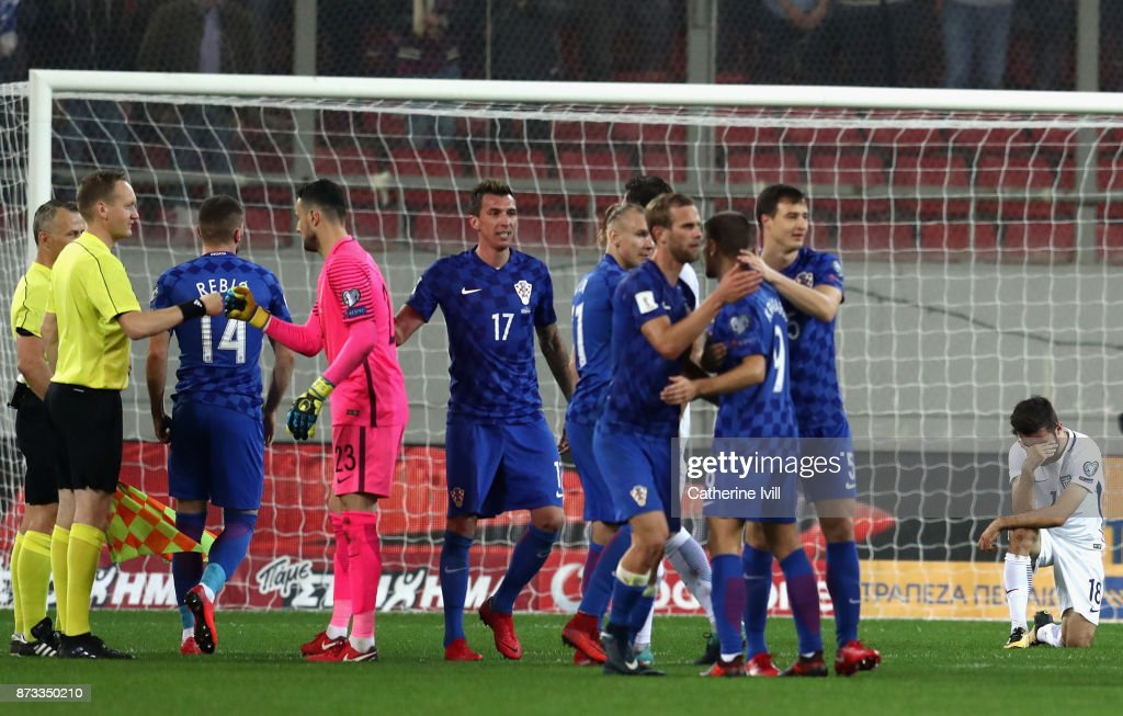 Croatia celebrate as Giannis Gianniotas of Greece looks dejected following the FIFA 2018 World Cup Qualifier Play-Off: Second Leg between Greece and Croatia at Karaiskakis Stadium on November 12, 2017 in Piraeus, .