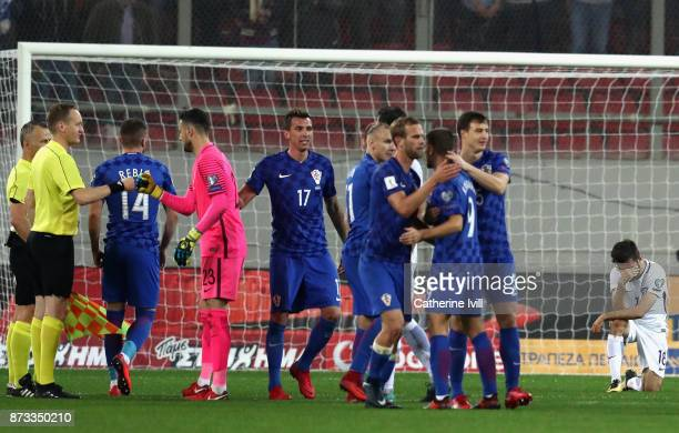 Croatia celebrate as Giannis Gianniotas of Greece looks dejected following the FIFA 2018 World Cup Qualifier PlayOff Second Leg between Greece and...