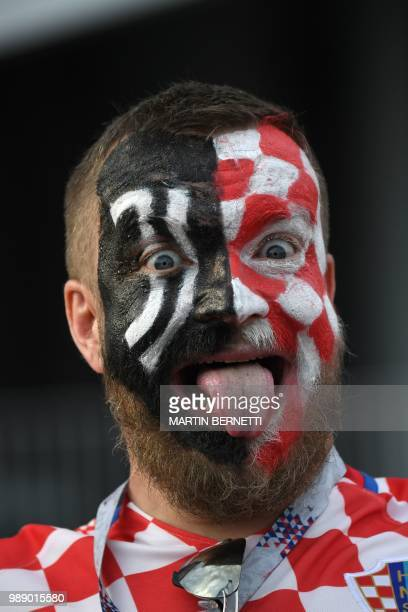 A Croatia fan reacts before the Russia 2018 World Cup round of 16 football match between Croatia and Denmark at the Nizhny Novgorod Stadium in Nizhny...