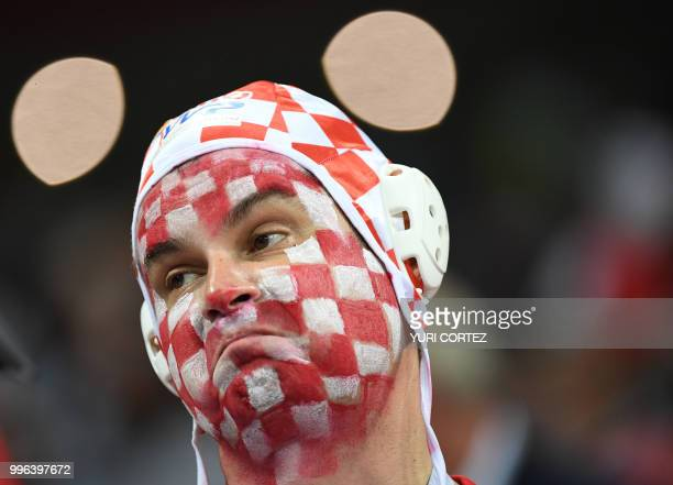 A Croatia fan reacts during the Russia 2018 World Cup semifinal football match between Croatia and England at the Luzhniki Stadium in Moscow on July...