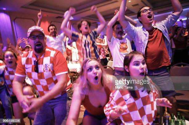 Croatia fans celebrate at a watch party in Saint Anthony Croatian Catholic Church at the moment Croatia defeated England 21 to advance to the World...