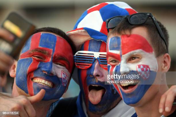 Croatia fans cheer before the Russia 2018 World Cup Group D football match between Iceland and Croatia at the Rostov Arena in Rostov-On-Don on June...