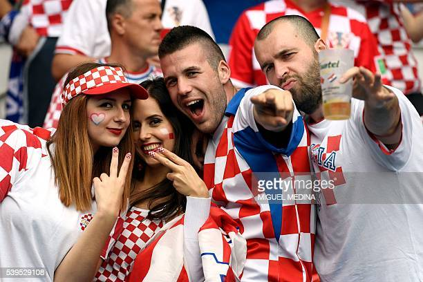 TOPSHOT Croatia fans pose for pictures ahead of the start of the Euro 2016 group D football match between Turkey and Croatia at the Parc des Princes...
