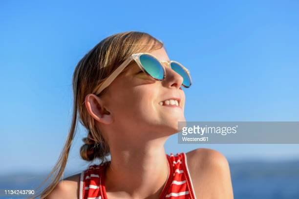 croatia, lokva rogoznica, portrait of sunbathing girl on the beach wearing sunglasses - girls sunbathing stock pictures, royalty-free photos & images