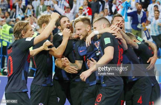 Croatia players celebrate after Ante Rebic scored a goal during the second half of Croatia's 30 win over Argentina in a World Cup Group D match in...